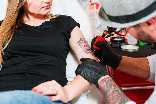 Professional tattooist makes tattoo