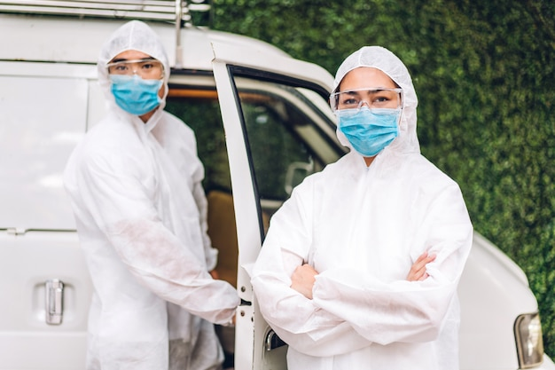 Professional teams for disinfection worker in protective mask and white suit disinfectant spray cleaning virus for help service kill coronavirus at customer home