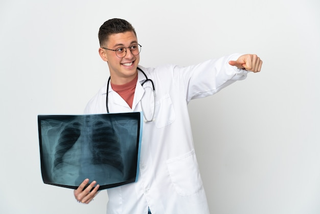 Professional traumatologist on white background giving a thumbs up gesture