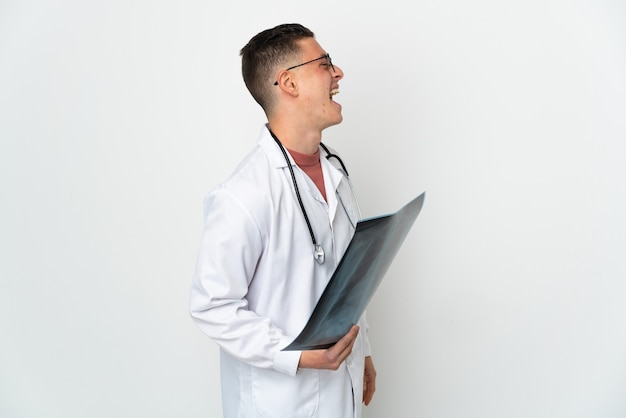 Professional traumatologist on white background laughing in lateral position