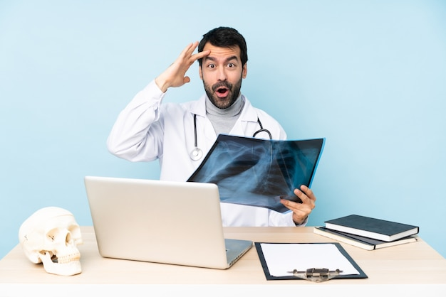 Professional traumatologist in workplace has just realized something and has intending the solution