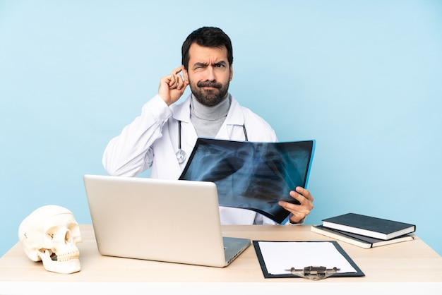 Professional traumatologist in workplace having doubts