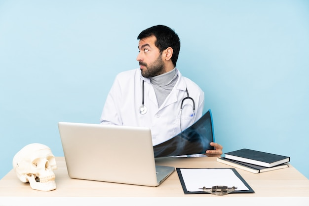 Professional traumatologist in workplace making doubts gesture looking side