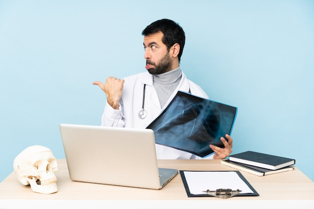 Professional traumatologist in workplace unhappy and pointing to the side