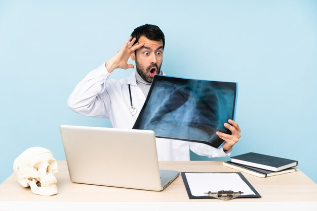 Professional traumatologist in workplace with surprise expression