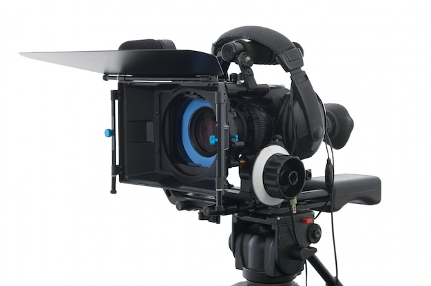Professional video camera on the white