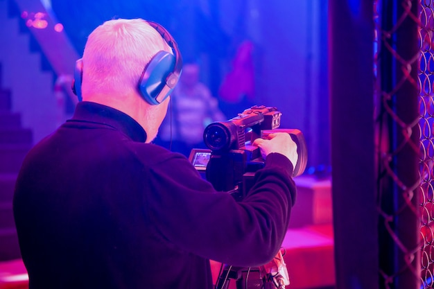 Professional video technician at work. videographer for the event, rear view.