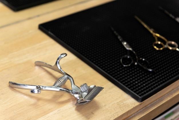 Professional vintage clipper machine in barber shop. vintage hairdresser work space