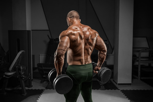 Professional weightlifter is training in the gym. back exercises. bodybuilding concept.