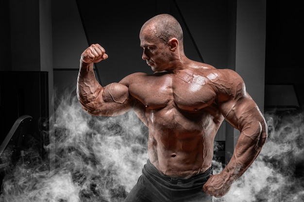 Professional weightlifter posing in the gym. classic bodybuilding.