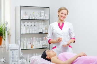 Professional woman smiling with a client lying