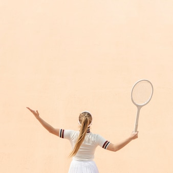 Professional woman tennis player on field