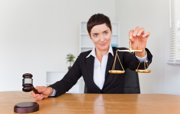 Professional woman with a gavel and the justice scale