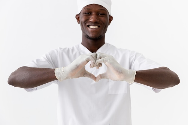 Professional young doctor making a heart shape