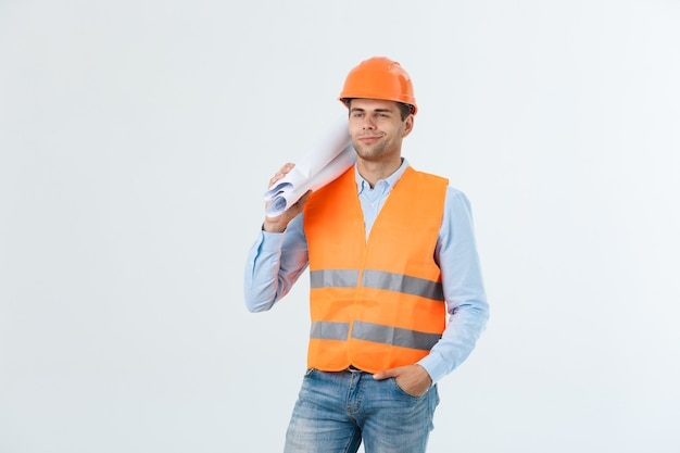 Professional young engineer with blueprint, isolated on white.
