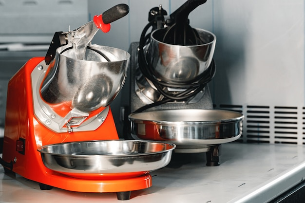 Proffesional new citrus juicers on shelf in a shop close up