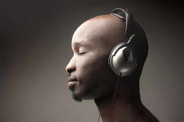 Profile of a black man with headphones