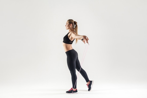 Profile blonde woman holding skipping rope
