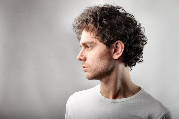 Profile of a curly-haired man