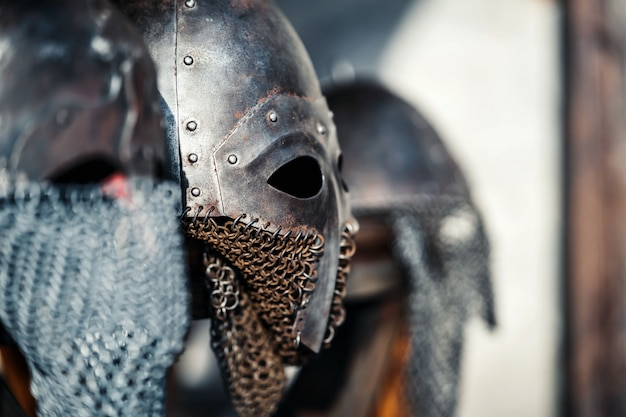 Profile of medieval old knightly helmets for protection in battle. heavy headgear on a stand. medieval armor concept