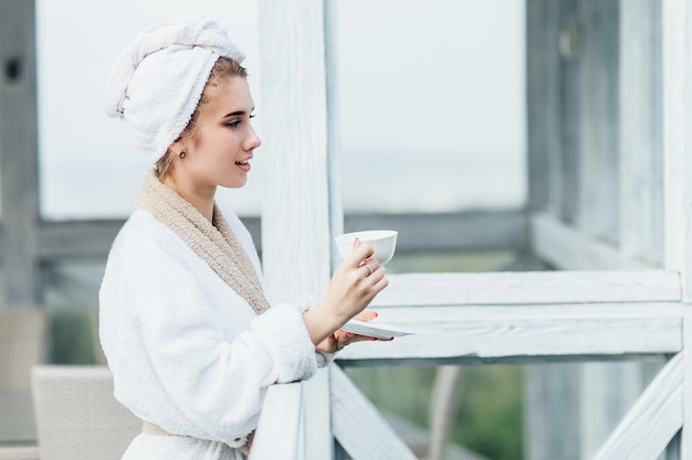 Profile photo. beauty concept, smiling girl have a weekend time and holding cup with tea, nice morning.