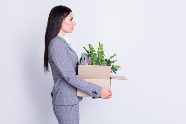 Profile photo of displeased worker lady world finance crisis lost job work hold carton box own stuff fired quit leave office building for good proud formalwear isolated grey color background