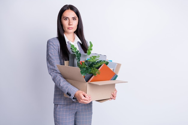 Profile photo of displeased worker young lady hate world financial crisis lost dream job work hold carton box stuff fired quit leave office formalwear isolated grey color background