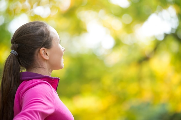Profile portrait of an attractive sport woman outdoors