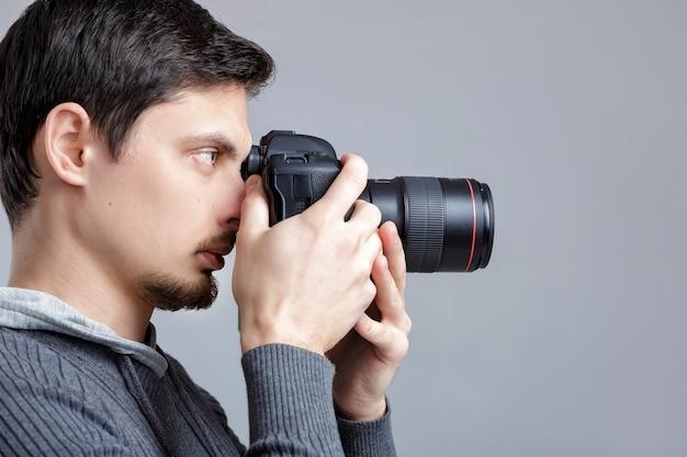 Profile portrait of successful professional photographer use dsl
