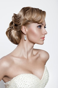 Profile portrait of a young blonde bride