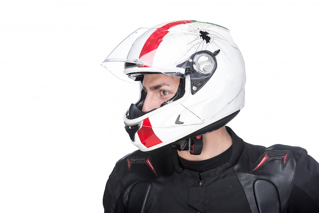 Profile portrait of a young motorcyclist with helmet.