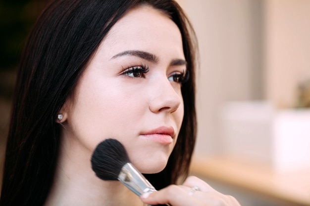 Profile of pretty brunette girl with long eyelashes