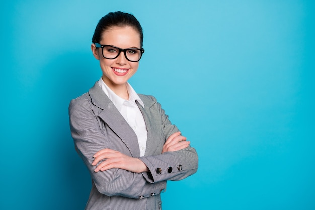 Profile side view of attractive cheerful smart businesslady employer folded arms isolated over bright blue color background