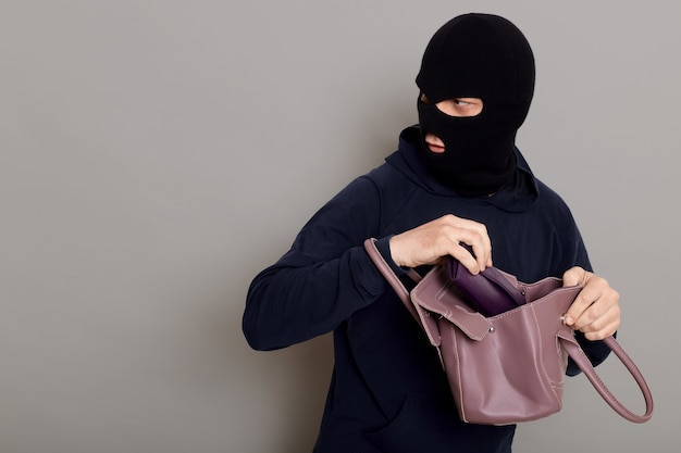 Profile of a thief guy with a masked face