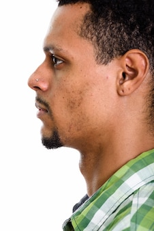 Profile view of face of young african man isolated on white