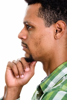 Profile view of face of young african man thinking isolated on white