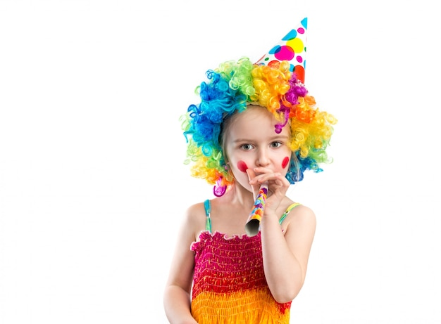 Profile view of little girl in clown wig