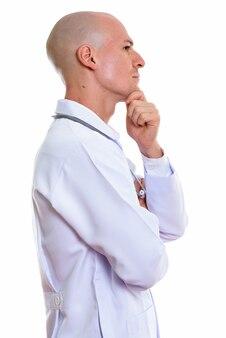 考えて若いハンサムなハゲ男医師のプロフィール