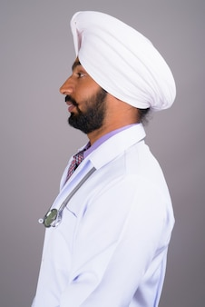 Profile view portrait of indian sikh man doctor