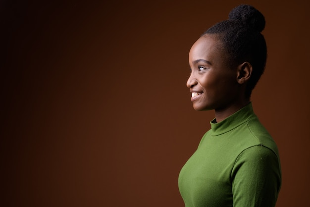 Profile view portrait of young african zulu businesswoman smiling