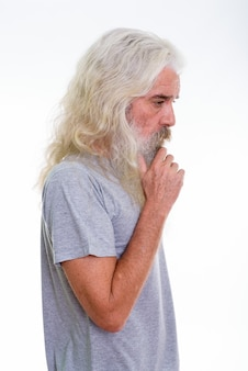 Profile view of senior bearded man thinking