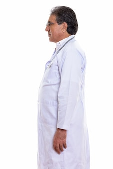 Profile view of senior persian man doctor standing