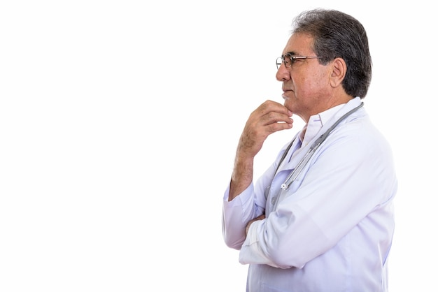 Profile view of senior persian man doctor thinking