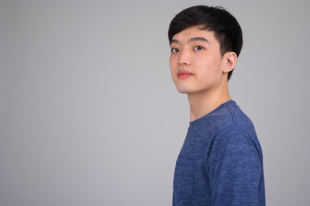 Profile view of young asian man