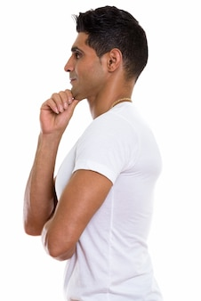 Profile view of young muscular persian man thinking