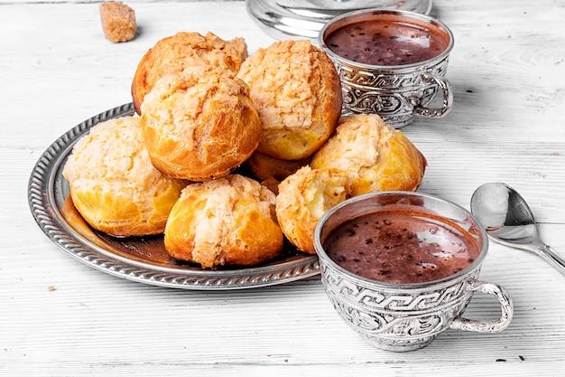 Profiteroles dessert and hot chocolate