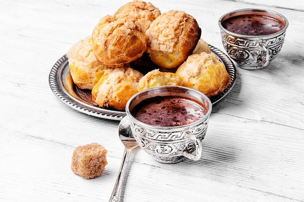 Profiteroles and hot chocolate