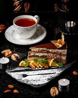 Profitrole cake with orange slice
