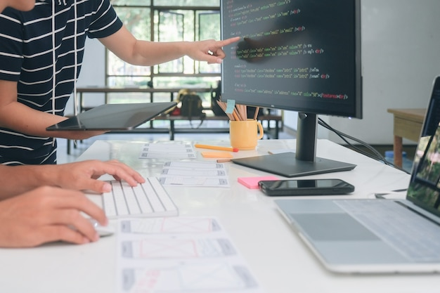 Programmer and ux ui designer working in a software development and coding technologies. mobile and website design and programing development technology.
