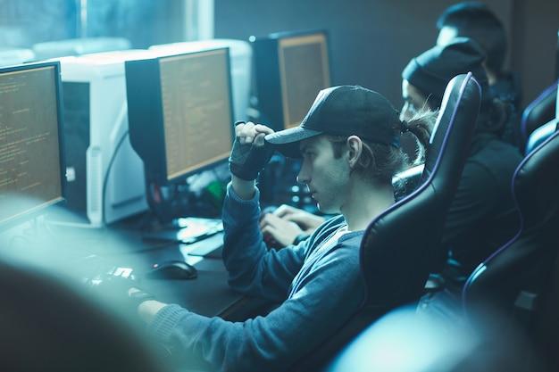 Programmers coding computer app